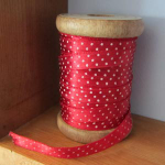 White dotted red ribbon